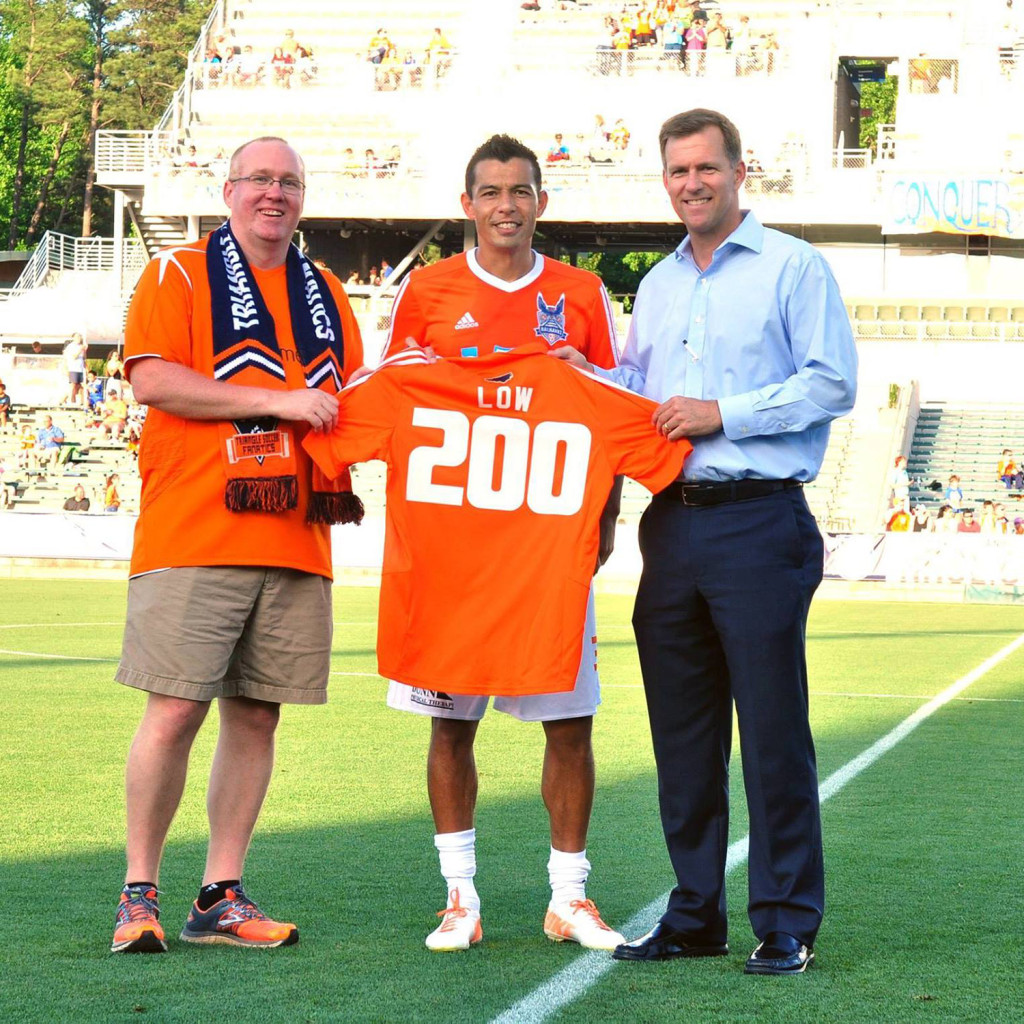 Kupono Low is presented with a commemorative jersey for his 200th game with Carolina (Photo: Carolina Railhawks)