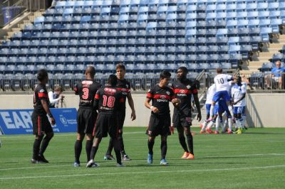 Scorpions commiserate while the Eddies Celebrate. (Photo Courtesy FC Edmonton)