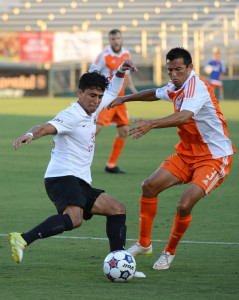 Kupono Low defends against San Antonio's Cesar Elizondo in 2015 (Photo:Rob Kinnan/Carolina RailHawks)
