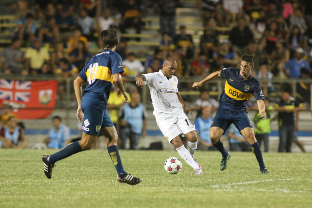 Fort Lauderdale Strikers midfielder Gabriel Rodrigues dos Santos cuts between two Boca Juniors players in an international friendly match on July 1 at Lockhart Stadium. (Photo courtesy of Jon van Woerden / Fort Lauderdale Strikers)