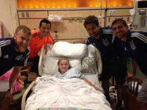 Kupono Low joins Railhawks teammates at a local hospital (Photo: Carolina Railhawks)
