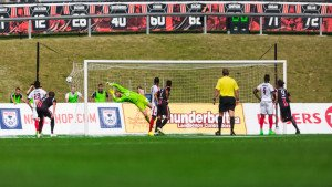 Ottawa's Heinemann sends a ball past Kristian Nicht (Photo by Richard A. Whittaker/Ottawa Fury)