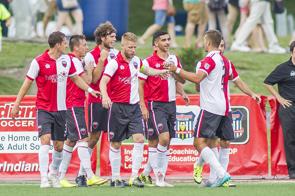 Ottawa celebrate after scoring (Photo: Trevor Ruszkowski/Indy Eleven)