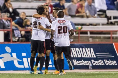 Forward Giuseppe Gentile mobbed by teammates after scoring his first San Antonio Scorpions goal (Photo: Matt Schlotzhauer)